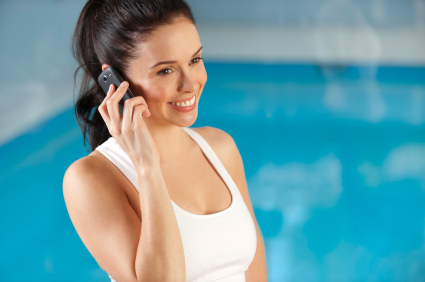Attractive woman on the phone at the gym